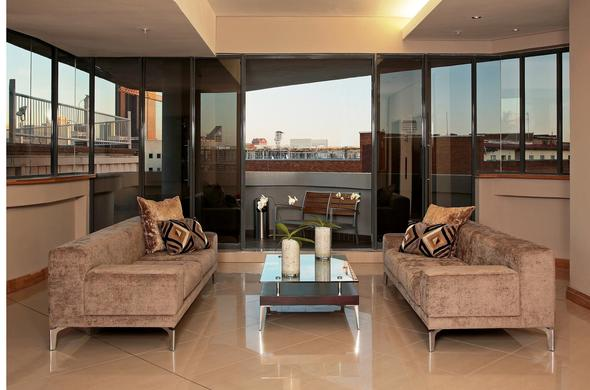 Chic lounge area with balcony.