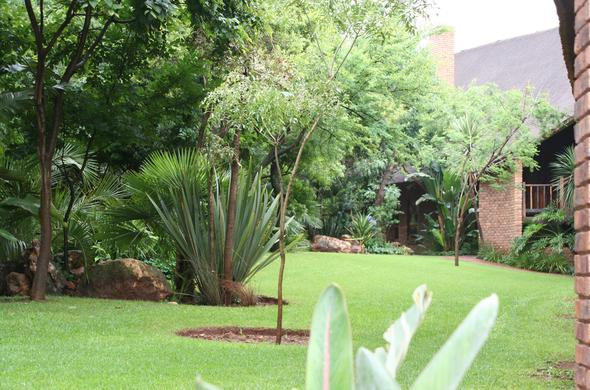 Beautifully manicured garden at Leriba Hotel.