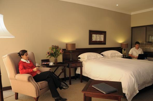 Comfortable double bedroom at Leriba Hotel.