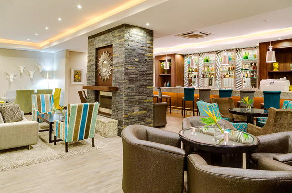 Chic bar and lounge area at Protea Hotel Capital.
