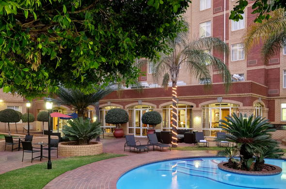 Swimming Pool with comfortable lounges at Protea Hotel Centurion.